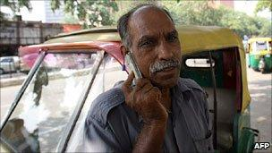 Indian man with a mobile telephone